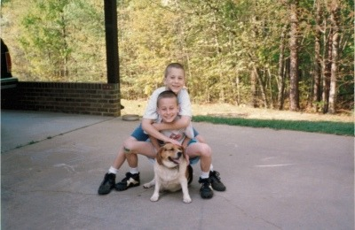 Brothers Cody, age 7 (top), and Brodie, age 9 (middle), with Gypsy, May 1995.