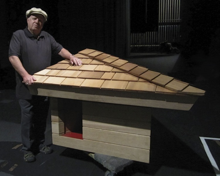 "Jim Berger with the rebuilt doghouse dubbed ""Eddie's House"""