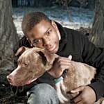 Young Chicagoan Terrence Murphy and his dog Elmo.